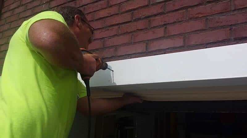 lintel lift repair happening with screw driver